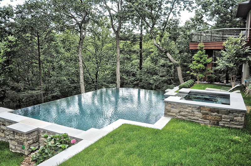 geometric pool with elevated spa